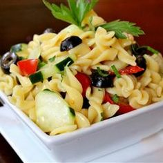 Easy Cold Pasta Salad Recipe Salads with rotini, cucumber, onion, cherry tomatoes, pitted black olives, salad dressing