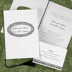 The front of this invite offers a cut out circle where you are able to see your names and a tassel that ties together at the side.
