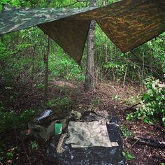 Not all adventures go as planned but that's what makes them an adventure! @thebeardedburton needed to act quick during a torrential downpour and setup a quick an reliable shelter to wait out the storm and stay dry until he could continue the adventure! Good thing he had the trusty Defender Camo tarp in his pack! #adventure #rainstorm #liveyourquest #aqwaterproof #bushcraft #camping