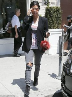 Hipster flair: The star Kourtney Kardashian teamed her tattered trousers with a graphic print T-shirt, loose blazer and booties
