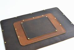 Dress up your desk with a SolidLeatherCo Leather Mouse Pad. Constructed from…