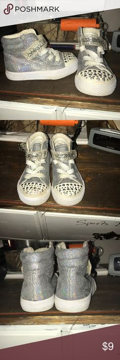 Size 5 silver shoes. Velcro on the top. Silver/glittery. Very similar to twinkle toes, just does not light up. Shoes Sneakers
