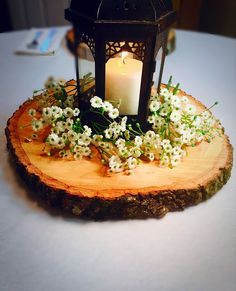 These wood slice centerpieces are a must have for any rustic wedding! They can also be used for wood chargers, cupcake stands, cake stands, & more! #weddingdecoration