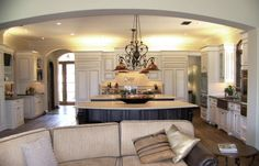 good size, add the breakfast nook, not sure about the archway between rooms?  Luke = agree on the size.  I don't like the arch.  Also, I would rather have the ceiling in the kitchen be lower then the great room with molding going around it to break up the rooms.  This one has the arch way lower then the ceiling in the kitchen.  make it feel cave like.
