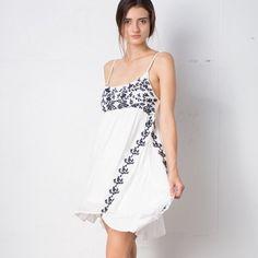 Slip dress Brand new off white slip dress with blue embroidered detail.  Adjustable straps April Spirit Dresses Mini