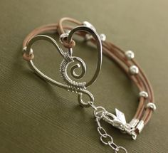 Funky heart wire wrapped sterling silver bracelet on Greek leather. $47.00, via Etsy.