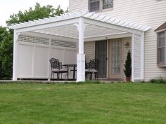 Add a privacy wall to the pergola to add a little separation from neighbors.