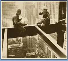 "1935: A lunch break high above ""the madding crowd"" is enjoyed by these two structural ironworkers."
