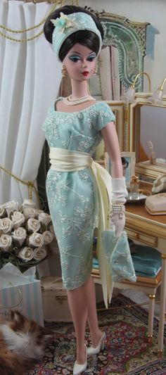 A very sophisticated vintage Barbie in a gorgeous sheath.  She loved her Barbies when Barbie came along,,,This was her doll, and she played endless times with her....