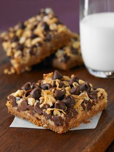 Magic Cookie Bars  Yield: 24 to 36 bars  2 cup(s) Semi-Sweet Chocolate Chips  1/2 cup(s) butter or margarine  1 1/2 cup(s) graham cracker crumbs  14 fluid ounce(s) sweetened condensed milk (NOT evaporated milk)  1 1/3 cup(s) flaked coconut  1 cup(s) chopped nuts