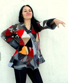 Crazy superb sweater patchwork denim top tunic. Made from recycled scraps of sweaters and grey denim. Crazy pop art style. Remade, reused, upcycled. Unique design. Hippie boho. Gypsy art soul. One of a kind. Size: L-XL (european 40-42) Bust line max 46 inches (117 cm) Hips line max 47 inches (120 cm) Length is different in the front and in the back. It is about 30 inches (76 cm) Hand wash i cold water - pure wool