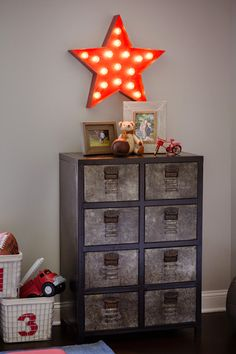 Locker-inspired dresser from @rhbabyandchild - such a great industrial accent in a boys room!