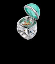 Deep Sea Ring:The watery mystery of the strange Paraiba Tourmaline, seemed to suggest hidden deaths. So this opening ring hides what lurks at the bottom of the sea. The Tourmaline is 49.27ct with a total carat weight of 0.47ct Diamonds & Enamel detail.
