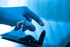 20218804 Doctor touching on digital tablet screen Royalty Free Stock Photo $8.00