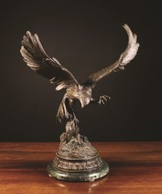LOT NUMBER 46  Jules Moigniez (1835-1894). A Brown Patinated Bronze Study of an Eagle with Prey, signed J. Moigniez and mounted on a vert marble base, 24 ins (61 cms) in height  Estimated sale price: £1800 - £2200  #auction #antique #auctionupdate #animal #sale #antiques #carving #bronze