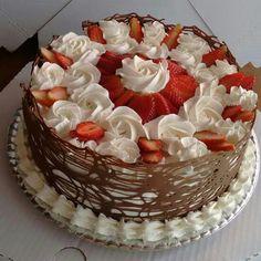 Strawberry shortcake with chocolate around outside