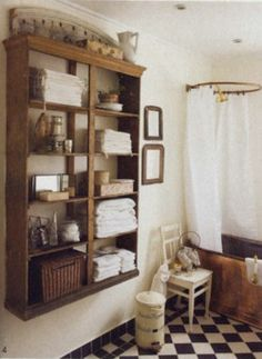 Awesome use of a wooden bookcase. Could add tall legs if needed.Bookcase (without a back) hung on the wall