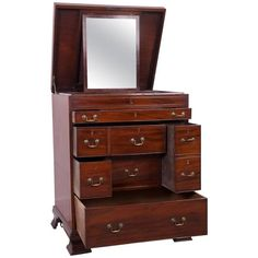 Bachelors Chest. A fine quality mahogany bachelor or gentleman's chest in the manner of Thomas Chippendale.  The top open to a glazed watch and jewelry compartment with velvet cushion liner, drop down mirror to the lift up top, a pull out secretaire with writing slope above a two section wine drawer and five other mixed drawers, the whole raised on bracket feet with inset castor. c 1760
