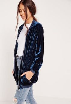 """Be a vixen in velvet and totally rock that sports luxe trend in this lavish longline bomber jacket. This seriously stylish garm is top of our wishlist this season, for sure. Featuring front zip fastening with pocket detail and all over velvet material, wear over a plain white tee with boyfriend jeans and trainers for a smart-casual vibe. Approx length 68cm/27"""" (Based on a UK size 8 sample) 92% Polyester 8% Elastane Lining 100% Polyester Yolanda wears a UK size 8/ EU..."