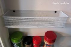 The Less Mess Project: Pantry Reveal! — Domestic Imperfection.  Dollar Tree Pencil drawer organizers screwed to the wall for extra pantry storage.
