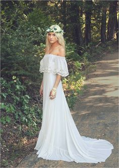 Bohemian bridal gown that can be worn on or off the shoulder. Dress Design: Daughters of Simone ---> http://www.weddingchicks.com/2014/05/10/bohemian-forest-themed-wedding-ideas/