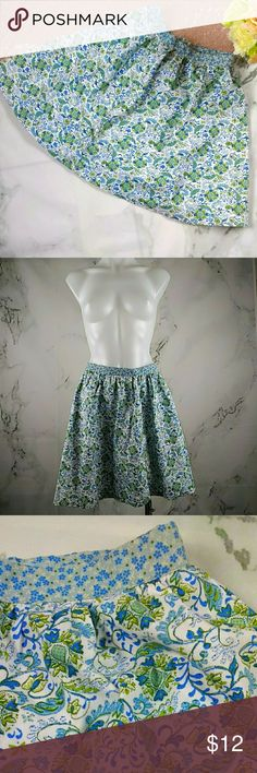 GAP KIDS – Skirt - FEATURES: Green and blue multi-color with flower design. Flares out at the bottom. Back zipper closure.  - CONDITION: Pre-owned. Good Used Condition. No Stains, rips or holes. Zipper moves smoothly.  - MATERIAL: Shell & Lining 100% Cotton  - MEASUREMENTS: Kids Size 10 Waist: 25 inches (full waist measurement)  Hips: 46 inches ((full hip measurement) Length: 15.5 inches   (#03) GAP Bottoms Skirts