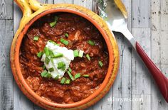 Texas Chili -What is the official dish of Texas? You guessed it. Chili con carne.  Chili originated from San Antonio Texas where in the 1880′s Mexican American women sold it from stands.  Texas chili may or may not have beans, and this one doesn't. Many Texans will swear that a true Texas chili shouldn't have legumes of any sort.  Some Texas chili recipes do not have tomatoes, but a broth created from a blend of chile peppers.