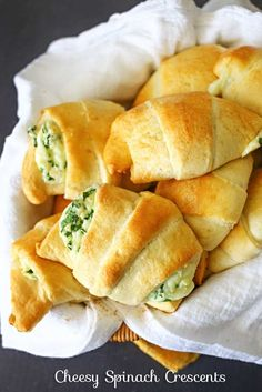 Cheesy Spinach Crescents - Light & fluffy crescent rolls loaded with melted cheese & spinach are easy & delicious! on kleinworthco.com #warmtraditions #ad