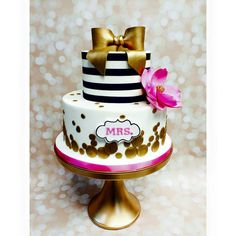 Black white and gold w/ pink accents engagement cake