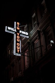 """St. Paul's House is a Church founded by J.J.D. Hall that is noted for its """"Sin Will Find You Out"""" neon sign in the shape of a cross that was featured on Saturday Night Live. St. Paul's House is a multifaceted ministry located in Hell's Kitchen on New York City's West Side. Photo by Marion Vitus on Flickr."""