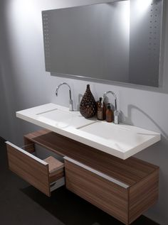 Sleek Sink With A Secret Contemporary, sleek and minimalistic are the first words that come to mind when describing this innovative sink design. Created by the designers at Giquardo in Italy, this sink has a personality all it's own.