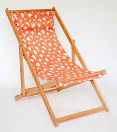 Trina Turk Orange and white outdoor fabric on white oak deck chair. I want to make these!