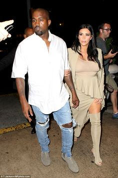 Date night:Unlike his wife, Kanye was rather more low key in his regular outfit of jeans ...
