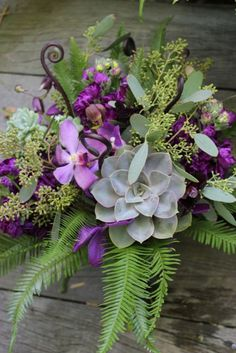 Australian Ferns, Fern Curls, Late Summer succulents with seeded euchylyptus and purple orchids to create a rustic bouquet with tons of texture.