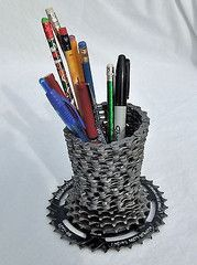 Recycled bicycle chain pencil or pen holer