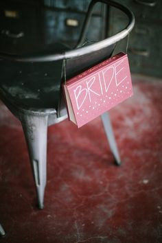 Easy #diy chair decor, perfect for a library wedding! photo by Awake Photography, design by Jennifer Laura Design http://ruffledblog.com/industrial-science-styled-shoot/