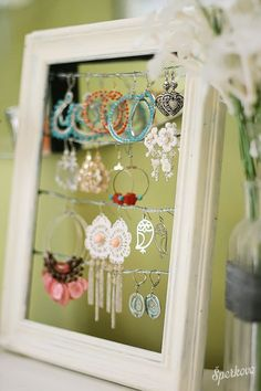 Paint frames, attach wire and hang on wall or inside closet door.