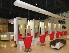 Carte Blanche Haute Coiffure in Orleans, Ont. I love the black, white and natural colours combined with the pop of red. It really adds to the atmosphere of the space.