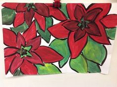 Fourth grade began their poinsettia paintings by sketching the flowers. We started with a star in the center and then drew leaves from each...