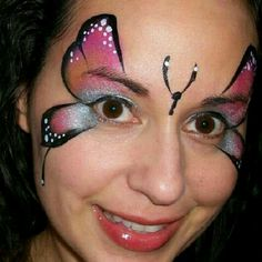 Pink and gold butterfly face paint