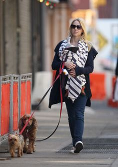 Naomi Watts has her hands full. The actress, who has her newborn son strapped to her chest, takes her two adorable pooches for a stroll through New York City.