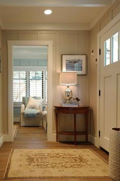 This elegant entry is painted in Sherwin-Williams' Accessible Beige SW7036.