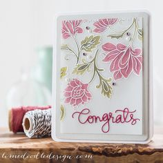 vellum white heat embossed flowers with colouring on the back