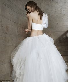 Modern interpretation: A particularly standout look from the presentation was a white strapless bustier top worn with a layered tulle skirt