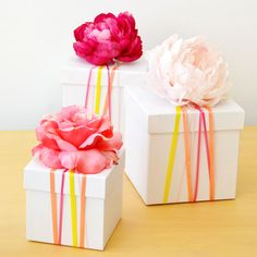 Ditch the wrapping paper and try this 5-minute DIY: Ribbon-wrapped gift boxes.