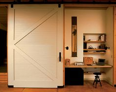 """Hidden home office using a sliding barn door. This home office brings a """"now you see it, now you don't"""" approach to bills and work tasks. By tucking the backless st. Barn Door In House, Barn Door Closet, Farm House, Interior Sliding Barn Doors, Sliding Doors, Home Office Closet, Office Nook, Closet Space, Closet Nook"""