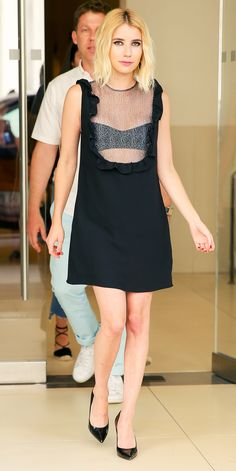 Emma Roberts took the sheer trend to the streets, stepping out in N.Y.C. in a sexy-sweet Wai Ming little black dress that featured an open ruffled neckline and a matching bralette.