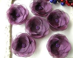Handmade flowers- sew on appliques    Diameter- approximately 2.5- 3 inches (6.5-8cm);    Materials used- mirror organza fabric, faux pearl beads;    Colors- deep purple fabric, white beads;    Quantity- 5pcs;    MORE LILIES- http://www.etsy.com/shop/JujaCrafts/search?search_query=water+lilies+-bobby&search_submit=&search_type=user_shop_ttt_id_5494845&shopname=JujaCrafts&langid_override=-1  Versatile- can be used for various sewing, embellishing, decorating projects (clothes adornment, hair…