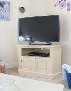 This neat and compact Cadence Corner TV Cabinet fits snugly into the corner of any smaller living room.