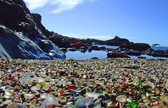 Glass Beach in Ft. Bragg, California.  The smooth pieces of colored glass were originally from a city dump at this beach site and have been polished by the tides over years.  I have also found pieces of polished pottery, marbles smoothed out of their round shape and silverware sticking out of the banks